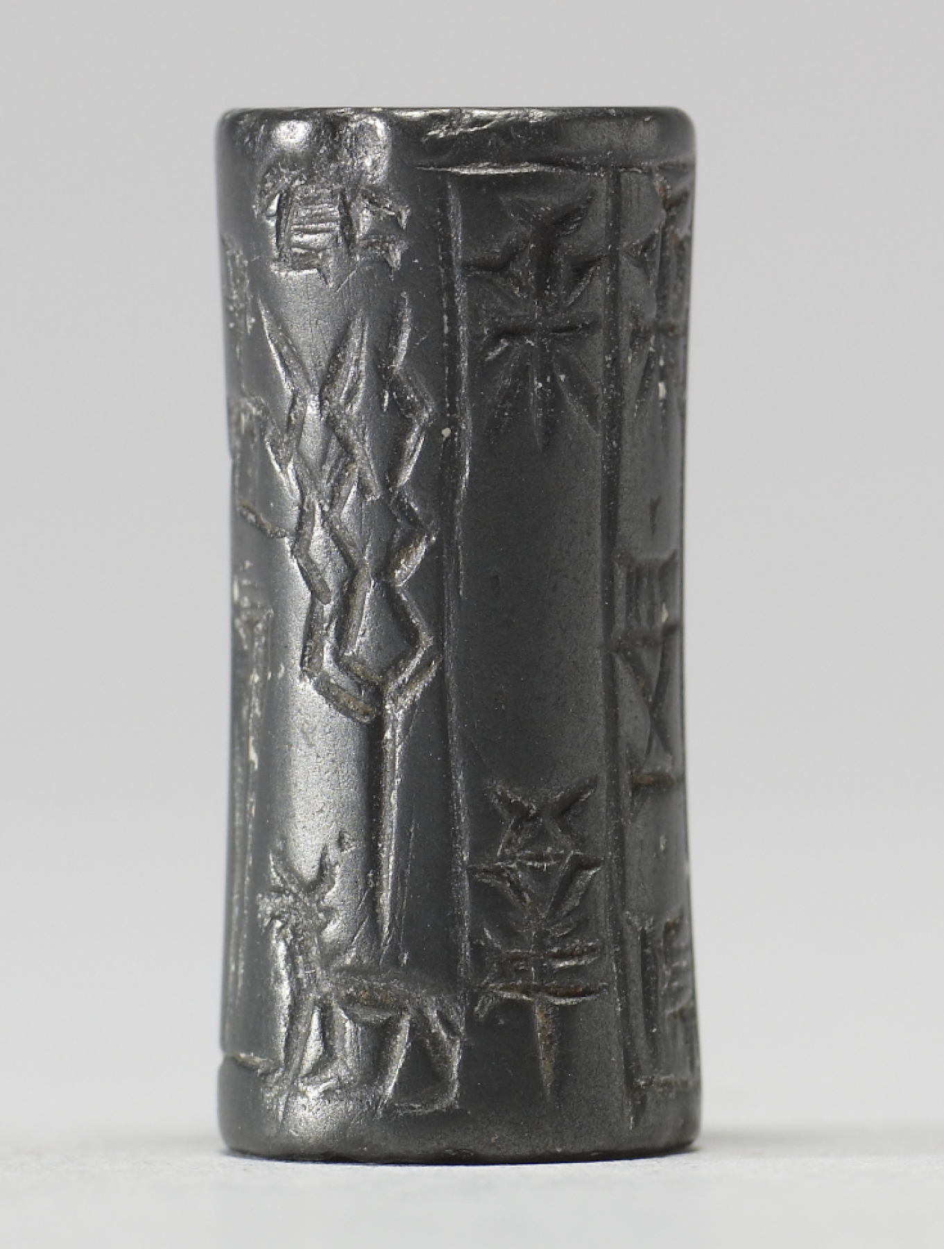 Babylonian_-_Cylinder_Seal_with_Three_Standing_Figures_and_Inscriptions_-_Walters_42692_-_Side_F